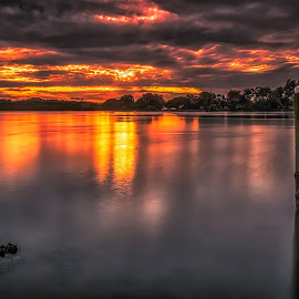 Explosion by Alex Stecina - Landscapes Waterscapes ( exciting, clouds, reflection, sky, explosion, sunset, wharf, shadows, fire, river )
