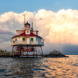 Heavy Clouds Behind the Lighthouse by Carol Ward - Buildings & Architecture Public & Historical ( clouds, annapolis, reflection, building, sunset, lighthouse, thomas point shoal lighthouse, maryland, chesapeake bay, architecture )