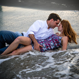 Romance By The Sea  by Prentiss Findlay - People Couples ( ocean romance, surf romance, love on the beach, beach romance, love by the sea )