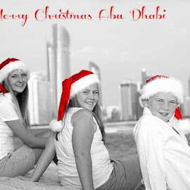 An Abu Dhabi Christmas by Beth Palmer - Typography Captioned Photos ( color block, christmas, abu dhabi, red hat, santa hat )