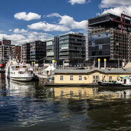 Speicherstadt (Hamburg, Germany) by Gianluca Presto - Buildings & Architecture Homes ( water, clouds, reflection, skyline, houses, building, europe, boats, cityscape, architecture, canal, hamburg, city, sky, buildings, germany, homes, river )