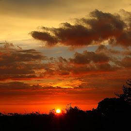 by Carmina Quesada - Landscapes Sunsets & Sunrises ( clouds, silhouette, sunset, landscape, sun )