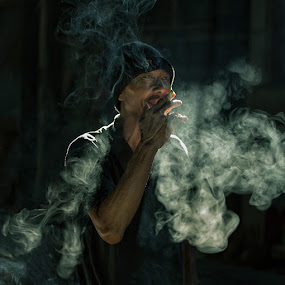 Smoking  by JNJ PhotoStream - People Street & Candids ( bali, canon1dx, market, indonesia, human natural, denpasar, light, smoke, man )