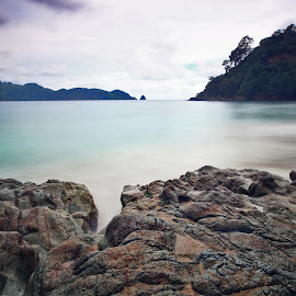 Rocky Edge by Novrisha Anggoro - Landscapes Beaches ( shore, waterscape, seascapes, landscaping, seascape, beach, landscape, waterscapes, landscape photography, long exposure, landscapes, longexposure, slow speed, rocks, slow shutter )