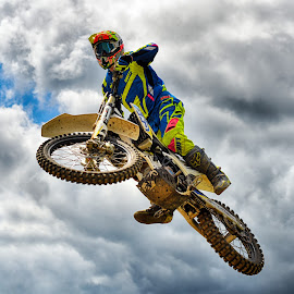 by Marco Bertamé - Sports & Fitness Motorsports ( clouds, wheel, speed, yellow, race, noise, jump, flying, motocross, blue, cloudy, air, grey, high )