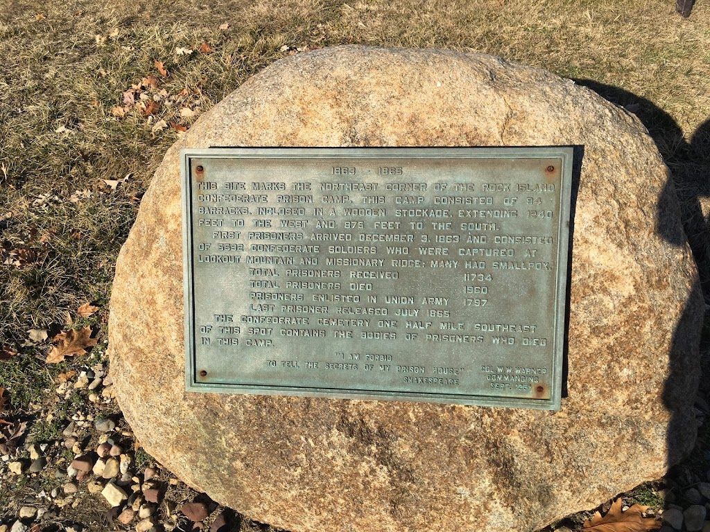 1863 – 1865 THIS SITE MARKS THE NORTHEAST CORNER OF THE ROCK ISLAND CONFEDERATE PRISON CAMP. THIS CAMP CONSISTED OF 84 BARRACKS, INCLOSED IN A WOODEN STOCKADE, EXTENDING 1240 FEET TO THE WEST AND 875 ...
