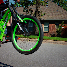 Action Shot by Amelia Rice - Transportation Bicycles ( bike riding, boys playing, bikes, bike tricks )