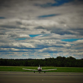 Grounded by Brant Stevenson - Transportation Airplanes ( clouds, airplane, runway, alone, grounded )