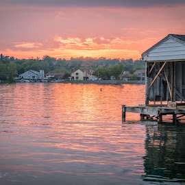 Sunset on the lake by Brian Butters - Landscapes Sunsets & Sunrises ( clouds, boat houses, water, canandaigua lake, sky, sunset, lake, evening, spring )
