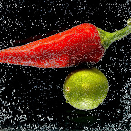Bubbly Red Pepper & Lime by Jim Downey - Food & Drink Fruits & Vegetables ( red pepper, underwater, bubbles, red green, lime, black )