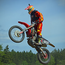 Standing ! by Marco Bertamé - Sports & Fitness Motorsports ( 203, green, aklone, forest, number, two hundred three, yellow, race, jump, red, sky, motocross, blue, competition )
