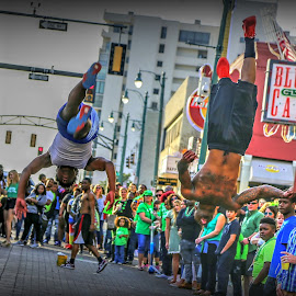Beale Street Flippers by Billy Morris - City,  Street & Park  Street Scenes ( jumpers, street, beale, people, flippers )