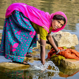 Doing laundry by Giancarlo Bisone - People Portraits of Women ( udaipur, woman, pink, india, laundry )