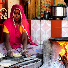 Roti Maker by Pinaki Pradhan - People Street & Candids