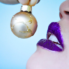 Christmas wish. by Eliani Miranda - Public Holidays Christmas ( face, ball, model, fashion, purple, pwcholidays, mouth, art, beautiful, christmas, beauty, finger, cute, teeth, people, photography, winter, girl, horizontal, woman, lips, eat, nikon, nose )