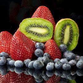 Kiwis and Berries by Jim Downey - Food & Drink Fruits & Vegetables ( strawberries, blueberries, reflective, black, kiwifruit )