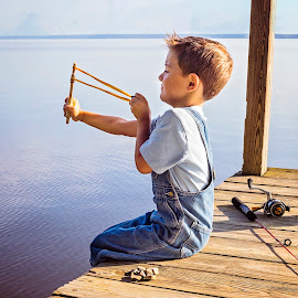 Slingshot by Sabrina Causey - Babies & Children Children Candids ( slingshot, pier, boy, lake, water,  )
