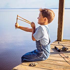 Slingshot by Sabrina Causey - Babies & Children Children Candids ( slingshot, pier, boy, lake, water )