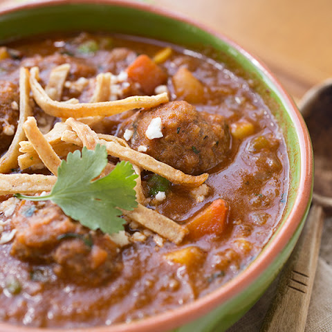 Spicy Albondigas Stew with Fresh Cilantro & Mint, topped with Crispy, Lime-Salted Tortilla Strips