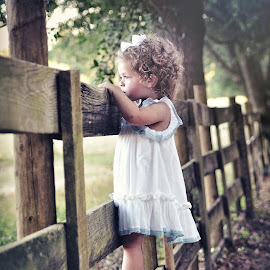 The other sie of the fence by Terri Cox - Babies & Children Children Candids