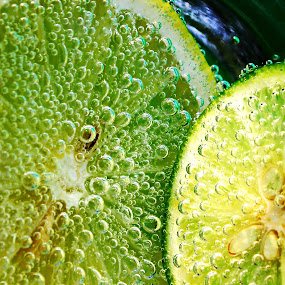 lemon and lime by Suehana SuZie - Food & Drink Fruits & Vegetables ( fruit, stock, bubbles, lime, yellow, lemon,  )