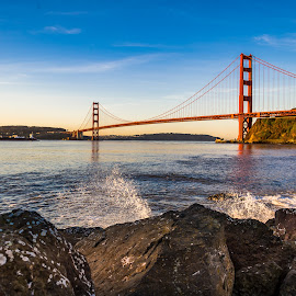 Golden Gate Bridge and rocks by John Rourke - Buildings & Architecture Bridges & Suspended Structures ( 2017, fort baker, marin county, water spray, golden gate bridge, ca, sun rise, california, landscape, usa, rocks, horseshoe bay )