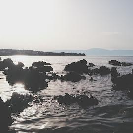 Rocks on the water by Gabrijel Vrebac - Landscapes Beaches ( seashore, sky, nature, rocky, sunset, beautiful, sea, rock formation, seascape, beauty, beach, rocks, sun )