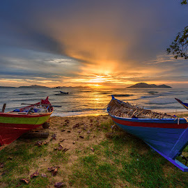 The Sun is Going Down by Buunlie Jayadi - Transportation Boats ( nature, sunsets, seascape, transportation, landscape )