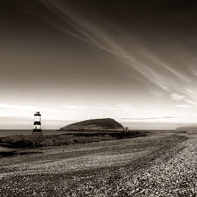 Penmon Beach by Mike Shields - Landscapes Beaches ( clouds, sky, black & white, lighthouse, sea, beach, stones, landscape, rocks )