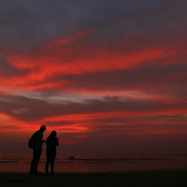 Paint the love by Shalini Jain - Landscapes Cloud Formations ( clouds, shades, red, silhouette, couple, beach, landscape )