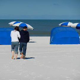 Young Lovers on Beach by Kathy Rose Willis - People Couples ( water, sand, walking, umbrellas, tents, girl, blue, florida, white, romantic, boy,  )