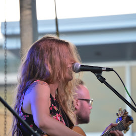 Hair in the face by Thomas Shaw - People Street & Candids ( microphone, band, glasses, woman, guitar, oak city 7, stage, hair, raleigh, north carolina, oc7 )