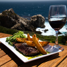 stead dinner and wine with Ocean background by Kathy Dee - Food & Drink Plated Food ( ocean, coastline, coast, sur, glass, resort, pino noir, lunch, fine, steak, wine, plated, california, plate, white, sea, tourism, table, dinner, tourist, red, wooden, blue, outdoor, background, outdoors, dining, big,  )