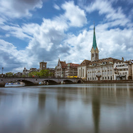 Zurich by Nikolas Ananggadipa - Buildings & Architecture Public & Historical ( clouds, church, neighborhood, long exposure, bridge, city, river )