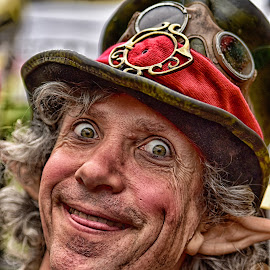 Harlequin by Marco Bertamé - People Portraits of Men ( red, ears, grimace, hat, eyes )