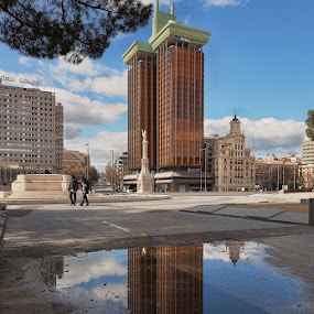 Reflection in a puddle by Wojciech Toman - City,  Street & Park  Historic Districts