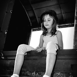 Girl on the Train by Mario Toth - Black & White Portraits & People ( sitting, girl, thinking, black and white, wagon, train, hat )