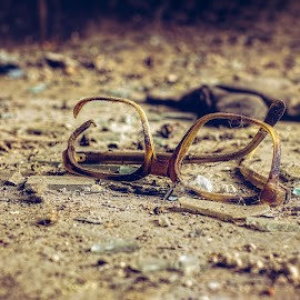 Forgotten in time by Opreanu Roberto Sorin - Artistic Objects Still Life ( optical, reading, fashion, cutout, concept, old, accident, glasses, street, destruction, retro, object, glow, shot, forgotten, bifocal, sight, break, style, accessory, glass, cracked, repair, eyesight, eyeglasses, eye, frustration, sand, vision, damage, broken glasses, lens, broken, frame, background, eyewear, cut, design, specs, out )