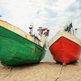 Fishing boats by Robert  Płóciennik - Transportation Boats ( shore, old, europe, relax, colorful, ship, fish, tropical, ocean, travel, transportation, beach, storm, coastline, landscape, coast, baltic, sky, nature, transport, sand, beautiful, sea, horizon, traditional, front, seascape, boat, holiday, color, blue, bay, sunset, summer, scene, day, fishing, fisherman, small, culture, design, nautical )