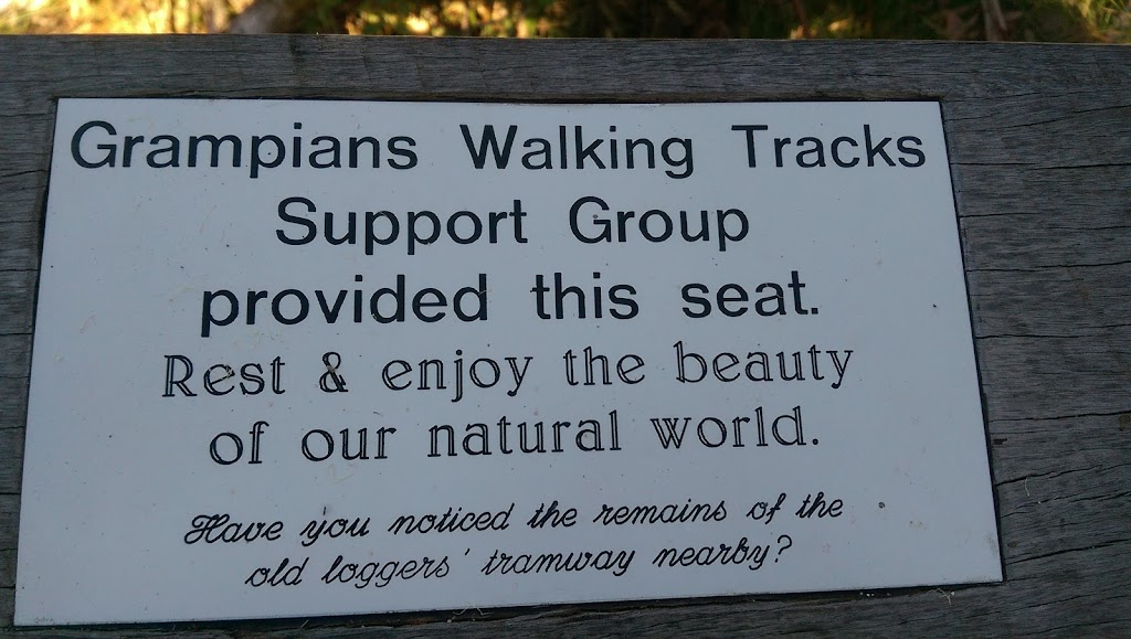 This plaque has been placed on the back of a park bench, on a walking track just outside Halls Gap.  You can only get to it by walking there! Plaque reads: Grampians Walking Tracks Support Group ...