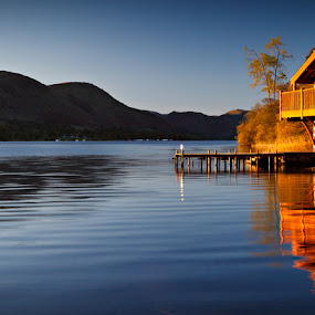 Boat house on Ullswater in the Lake District by Pete Barnes - Landscapes Waterscapes ( warm, boathouse, frost, lakes, keswick, wakefield, colour, sky, tree, cold, autumn, ice, duke of portland, art, derwent, mood, ullswater, derwent water, boat, morning, lake district, serene, cloud, sunrise, stunning )