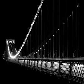 Bridge into the Dark by DJ Cockburn - Black & White Buildings & Architecture ( civil engineering, monochrome, black and white, river avon, clifton down, architecture, road, clifton, grayscale, lights, england, somerset, avon gorge, b3129, clifton suspension bridge, victorian, night, bristol )