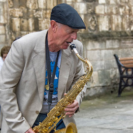 Busker in Lincoln by Kellee Wright - People Musicians & Entertainers ( saxophone, male, busker, candid, musician, man, hat )