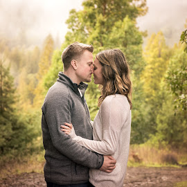 Love, Rain and Laughter  by Michael Keel - People Couples ( kiss, redwoods, fog, camping, trees, forest, mist, couples, engagement )