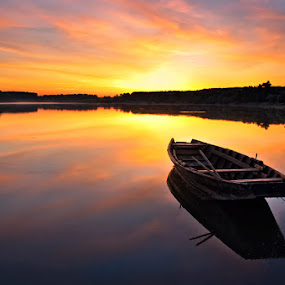 Sunrise by Catalin Palosanu - Landscapes Sunsets & Sunrises ( water, clouds, reflections, sunrise, boat, river )