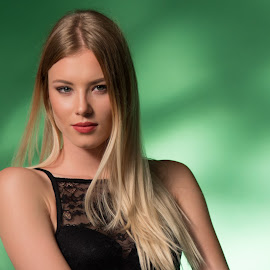 Girl by Mario Horvat - People Portraits of Women ( studio, girl, indoor, white, green background, pretty, young )