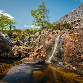 Mountain waterfall. by Haim Rosenfeld - Landscapes Mountains & Hills ( exposure, scotland, europe, mountain, colorful, waterfall, land, stone, reflections, rock, yellow, travel, north, landscape, adventure, sky, tree, kingdom, shadow, dreamlike, light, foreground, water, orange, united, uk, celtic, texture, colors, green, scottish, horizon, image, brawn, lake, scenic, highlands, photo, in, blue, outdoor, brown, scenery, stunning, britain )