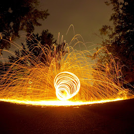 Sparks flying by West Guralnick - Abstract Light Painting
