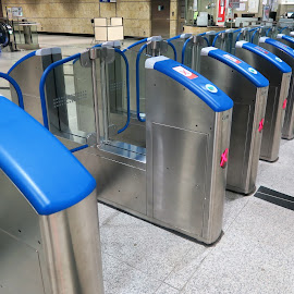 Blue Auto Gates by Dennis Ng - Transportation Trains