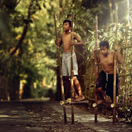 Egrang by Thomas Dian - Novices Only Portraits & People ( child, nature, teen, indonesia, stilts, play, traditional, boy, kid )